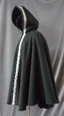 Cloak:2423, Cloak Style:Cape / Ruana Cloak with Knotworks Black Trim, Cloak Color:Black, Fiber / Weave:Ripstop WindPro Sherling Fleece, Cloak Clasp:Plain Rope<br>Hook & Eye, Hood Lining:Self-lining, Back Length:36&quot;, Neck Length:24&quot;, Seasons:Winter, Fall, Spring, Note:Luxurious, functional, and economically friendly!<br>This windpro cloak blocks more wind than a basic fleece<br>and has a water repelling outer finish!It&#039;s perfect<br>for New England winters and cold, rainy, windy climates.<br>The inside of the fabric wicks up moisture keeping you dry and warm.<br>Trimmed with a classic black & silver Knotworks trim.<br>Machine washable cold gentle, tumble dry low<br>Throw it on and go!.