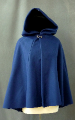 Cloak:2425, Cloak Style:Multi-panel semi circle, Cloak Color:Bright Navy Blue, Fiber / Weave:Heavy Wool Melton, Cloak Clasp:Plain Rope<br>Hook & Eye, Hood Lining:Unlined, Back Length:31&quot;, Neck Length:22&quot;, Seasons:Winter, Fall, Spring, Note:This bright navy blue short cloak is made from a<br>heavy wool melton, and features a full hood.<br>Sturdy and durable, this cloak will stand up to winter<br>weather with some wind resistance. &nbsp;Dry Clean only..