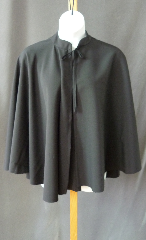 "Cloak:2471, Cloak Style:Full Circle Cloak, Cloak Color:Black, Fiber / Weave:Polyester suiting, Cloak Clasp:Black ties, Hood Lining:Unlined, Back Length:29"", Neck Length:19"", Seasons:Summer."