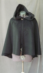 Cloak:2513, Cloak Style:Fuller Half Circle Child&#039;s, Cloak Color:Black, Fiber / Weave:Plush Wool Coating, Cloak Clasp:Plain Rope<br>Hook & Eye, Hood Lining:Unlined, Back Length:29&quot;, Neck Length:18.5&quot;, Seasons:Southern Winter, Fall, Spring, Note:This short cloak is a fuller half circle.<br>The smaller neck makes this a good choice for a child.