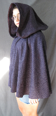 "Cloak:2520, Cloak Style:Fuller Half Circle Short, Cloak Color:Purple with Black Herringbone, Fiber / Weave:Herringbone Wool, Cloak Clasp:Alpine Knot - Silvertone, Hood Lining:Unlined, Back Length:26"", Neck Length:18"", Seasons:Fall, Spring."