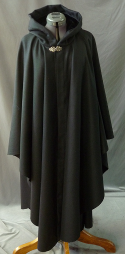 "Cloak:2555, Cloak Style:Ruana, Cloak Color:Black, Fiber / Weave:Wool/Nylon Blend, Cloak Clasp:Vale, Hood Lining:Black Velvet, Back Length:48"", Neck Length:23"", Seasons:Fall, Winter, Spring."