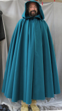 "Cloak:2556, Cloak Style:Full Circle Cloak, Cloak Color:Teal, Fiber / Weave:Faux Wool Polyester, Cloak Clasp:Triple Medallion, Hood Lining:Unlined, Back Length:54.5"", Neck Length:21.5"", Seasons:Fall, Winter, Spring."