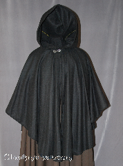 "Cloak:2565, Cloak Style:Cape / Ruana, Cloak Color:Black, Fiber / Weave:Wool Flannel, Cloak Clasp:Antiquity, Hood Lining:Unlined, Back Length:38"", Neck Length:21"", Seasons:Fall, Spring, Note:Note: on sale due to distress - small patches."