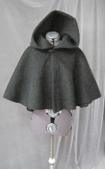 Cloak:2594, Cloak Style:Full Circle Short Cloak, Cloak Color:Black, Fiber / Weave:Heavy Wool Melton, Cloak Clasp:Plain Rope<br>Hook & Eye, Hood Lining:Unlined, Back Length:21&quot;, Neck Length:21&quot;, Seasons:Winter, Fall, Spring.