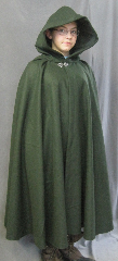 "Cloak:2605, Cloak Style:Fuller Half Circle, Cloak Color:Green, Fiber / Weave:Felted Medium Weight Melton, Cloak Clasp:Vale, Hood Lining:Dark Olive Moleskin, Back Length:42"", Neck Length:21"", Seasons:Winter, Fall, Spring, Note:Note, the model is 4' 10""."