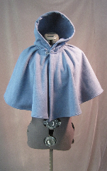 Cloak:2617, Cloak Style:Full Circle Short Cloak, Cloak Color:Colonial Blue, Fiber / Weave:WindPro Herringbone Fleece (wool-like exterior), Cloak Clasp:Plain Rope<br>Hook & Eye, Hood Lining:Self-lining, Back Length:20&quot;, Neck Length:19&quot;, Seasons:Winter, Fall, Spring.