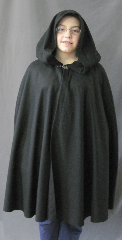 "Cloak:2666, Cloak Style:Shaped Shoulder, Cloak Color:Black, Fiber / Weave:Light Weight 100% Wool Flatweave, Cloak Clasp:Vale, Hood Lining:Unlined, Back Length:35"", Neck Length:21"", Seasons:Fall, Spring, Note:Professional dry clean only."