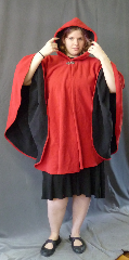 Cloak:2667, Cloak Style:Cape / Ruana, Cloak Color:Red Outside, Black Inside, Fiber / Weave:Windblock Polar Fleece, Cloak Clasp:Vale, Hood Lining:Self-lining, Back Length:35&quot;, Neck Length:21&quot;, Seasons:Winter, Fall, Spring, Note:This two toned red & black ruana / poncho style cloak<br>is made of  WindBloc Polar fleece, which is 100% wind resistant,<br> and has a water-repelling outer finish! It&#039;s perfect<br>for New England winters and cold, rainy, windy climates.<br>The inside of the fabric wicks up moisture keeping you dry and warm. <br>Machine washable cold gentle, tumble dry low ONCE<br>with the inside out, allow to air-dry the rest of the way..