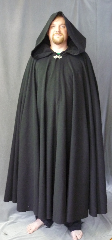 Cloak:3348, Cloak Style:Full Circle Cloak<br>with lirapipe hood, Cloak Color:Black, Fiber / Weave:Fleece, Cloak Clasp:Vale, Hood Lining:Unlined, Back Length:57&quot;, Neck Length:23&quot;, Seasons:Fall, Spring, Note:Lightweight black economy fleece<br>full circle cloak provides a warmth<br>with very little weight.<br>Suitable for indoor wear late spring,<br>early fall, cool summer evenings<br>or just snuggling on the couch.<br>Vale clasp perfect for<br>football spectators and players.<br>Machine washable..