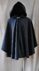 Cloak:2734, Cloak Style:Cape / Ruana, Cloak Color:Navy Blue Heathered with Navy and Black, Fiber / Weave:80/20 Wool Blend, Cloak Clasp:Vale, Hood Lining:Unlined, Back Length:34&quot;, Neck Length:19&quot;, Seasons:Winter, Fall, Spring, Note:This short cape/ruana is perfect<br>for adding just a touch of drama and elegance.<br>Made from a navy blue nylon/wool this cloak is unlined<br>and finished off with a classic Vale hook-and-eye clasp.<br>Dry Clean Only..