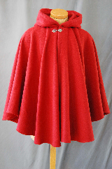 Cloak:2750, Cloak Style:Full Circle Short Cloak, Cloak Color:Red, Fiber / Weave:80/20 Wool Blend, Cloak Clasp:Vale, Hood Lining:Unlined, Back Length:33&quot;, Neck Length:20&quot;, Seasons:Winter, Fall, Spring, Note:This short full circle cloak is perfect<br> for adding just a touch of drama and elegance.<br>Made from a red nylon/wool this cloak is soft,<br>unlined. and finished off with a classic Vale hook-and-eye clasp.<br> Dry Clean only.