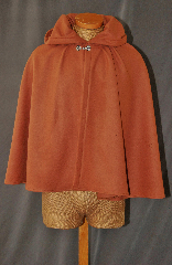 Cloak:2753, Cloak Style:Full Circle Short Cloak, Cloak Color:Golden Brown / Caramel, Fiber / Weave:100% Wool, Cloak Clasp:Vale - Goldtone, Hood Lining:Unlined, Back Length:24&quot;, Neck Length:21&quot;, Seasons:Winter, Fall, Spring, Note:This short full circle cloak is perfect<br> for a child or adult.<br>Made from a Caramel wool,<br>this midweight cloak is soft.<br>Features an unlined hood,<br>finished off with a Goldtone<br>Vale hook-and-eye clasp.<br>Dry Clean only.