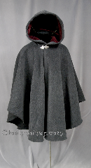 Cloak:2773, Cloak Style:Cape / Ruana extra long over the shoulder, Cloak Color:Grey and Black, Fiber / Weave:Plush 100% Wool Melton with Herringbone Pattern, Cloak Clasp:Triple Medallion, Hood Lining:Burgundy Velvet Lining, Back Length:37&quot;, Neck Length:23&quot;, Seasons:Winter, Fall, Spring, Note:This gorgeous Plush Wool Melton cloak<br>with herringbone Pattern<br>has a lovely Scottish Irish look.<br>A cross between a cape and a cloak,<br>a ruana is a great way to keep warm when<br>frequent, unhindered use of your arms is needed.<br>Ruanas make great driving cloaks!<br>Dry Clean only..