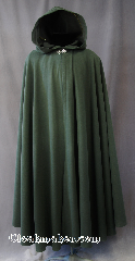 Cloak:2797, Cloak Style:Full Circle Cloak, Cloak Color:Dark Green, Fiber / Weave:100% Polyester, Cloak Clasp:Vale, Hood Lining:Unlined, Back Length:53&quot;, Neck Length:21&quot;, Seasons:Fall, Spring, Note:This light to midweight dusty green cloak<br>has a soft microfiber outer texture<br>and enough weight for a<br>dramatic swoosh and drape as<br>you make an entrance or exit.<br>Perfect for cool evenings<br>and tightly woven enough for a<br>little wind protection.<br>Accented with a Silvertone Vale<br>hook-and-eye clasp..