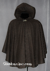 Cloak:2798, Cloak Style:Cape / Ruana, Cloak Color:Heathered Brown, Fiber / Weave:80% wool, 20% nylon, Cloak Clasp:Vale, Hood Lining:Unlined, Back Length:33&quot;, Neck Length:20&quot;, Seasons:Summer, Fall, Note:This Soft Heathered brown cloak<br>has a lovely drape and is perfect<br>for cool fall evenings.<br>Shallow cut sides allow for easy arm<br>movement for driving while still<br>providing coverage.<br>The heathered coloring allows for greater<br>depth of color to go with many outfits.<br>Dry Clean only..