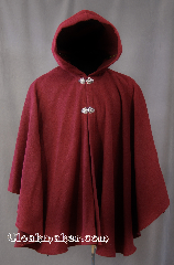 Cloak:2802, Cloak Style:Ruana Cloak Casco Bay inspired, Cloak Color:Burgundy, Fiber / Weave:80% Wool/20% Nylon, Cloak Clasp:Vale, Hood Lining:Unlined, Back Length:31&quot;, Neck Length:20&quot;, Seasons:Spring, Fall, Note:Inspired by the former Casco<br>Bay Works in Portland, Maine.<br>This gorgeous Ruana cloak is perfect for<br>cool fall evenings. Shallow cut sides<br>allow for easy arm movement for<br> driving while still providing coverage.<br>Finished with 2 Vale hook & eye clasps<br>Dry Clean only..