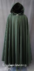 Cloak:2803, Cloak Style:Full Circle Cloak, Cloak Color:Dark Green, Fiber / Weave:100% Polyester, Cloak Clasp:Vale, Hood Lining:Unlined, Back Length:53&quot;, Neck Length:23.5&quot;, Seasons:Fall, Spring, Note:This light to midweight dusty green cloak<br>has a soft microfiber outer texture<br>and enough weight for a<br>dramatic swoosh and drape as<br>you make an entrance or exit.<br>Perfect for cool evenings<br>and tightly woven enough for a<br>little wind protection.<br>Accented with a Silvertone Vale<br>hook-and-eye clasp..