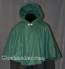 Cloak:2828, Cloak Style:Full Circle Short Cloak, Cloak Color:Forest Green, Fiber / Weave:Polyester Economy Fleece, Cloak Clasp:Alpine Knot - Goldtone, Hood Lining:Unlined, Back Length:23.5&quot;, Neck Length:21&quot;, Seasons:Fall, Spring, Note:Perfect for covering up your shoulders<br>while waiting for the car to warm up,<br>this light-weight fleece cape is<br>versatile and easy to maintain.<br>It is machine washable and features a<br>gold-tone Alpine Knot clasp..