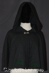 Cloak:2834, Cloak Style:Shaped Shoulder Cloak - Short, Cloak Color:Grey<br>Green embroidery, Fiber / Weave:100% Wool, Cloak Clasp:Alpine Knot - Silvertone, Hood Lining:Unlined, Back Length:20&quot;, Neck Length:22&quot;, Seasons:Summer, Fall, Spring, Note:&quot;The woods are lovely, dark and deep.<br>But I have promises to keep, and miles<br>to go before I sleep.&quot; Robert Frost<br>This embroidered wool cloak<br>will keep you or your child<br>warm on those long walks.<br>A perfect starter cloak lightweight<br>and sized for play and walking<br>100% wool. Dry clean only..