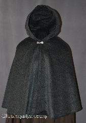 Cloak:2846, Cloak Style:Shaped Shoulder Cloak - Short, Cloak Color:Grey, Fiber / Weave:80% Wool / 20% Nylon, Cloak Clasp:Alpine Knot - Goldtone, Hood Lining:Unlined, Back Length:28&quot;, Neck Length:19&quot;, Seasons:Spring, Fall, Southern Winter, Winter, Note:Warm and soft this Grey wool blend<br>short cloak is long enough to protect<br>an adult torso or child from cool evenings<br>Dry clean only..
