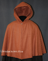 Cloak:2859, Cloak Style:Shaped Shoulder Cloak - Short, Cloak Color:Caramel, Fiber / Weave:80% Wool / 20% Nylon, Cloak Clasp:Plain Rope<br>Hook & Eye, Hood Lining:Unlined, Back Length:22&quot;, Neck Length:20&quot;, Seasons:Spring, Fall, Southern Winter, Winter, Note:Made from a Caramel wool,<br>this mid-weight cloak is soft.<br>It features an unlined hood,<br>and is finished off with a<br>silver tone plain rope hook<br>and eye clasp.<br>Perfect for a child or adult.<br>Dry clean only..