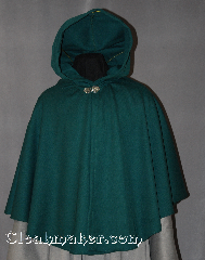 Cloak:2862, Cloak Style:Full Circle Short Cloak, Cloak Color:Green, Fiber / Weave:100% Wool, Cloak Clasp:Vale, Hood Lining:Unlined, Back Length:29&quot;, Neck Length:22&quot;, Seasons:Spring, Fall, Note:This green cape / short full circle cloak<br>is made of a lightweight wool which allows<br>for a dramatic drape -- perfect<br>for cool evenings. Short enough<br>for a full range of daily activities;<br>it&#039;s accented with a silver tone<br>Vale hook-and-eye clasp.<br>Dry Clean only..