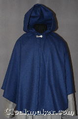 Cloak:2867, Cloak Style:Shaped Shoulder Ruana Cloak, Cloak Color:Navy Blue, Fiber / Weave:100% Wool, Cloak Clasp:Alpine Knot - Silvertone, Hood Lining:Unlined, Back Length:30&quot;, Neck Length:19&quot;, Seasons:Spring, Fall, Note:This soft navy blue wool Ruana cape<br>is light enough for a fall outing<br>without adding too much bulk.<br>It is versatile for formal or daily use with<br>shortened sides for ease arm movement.<br>Dry clean only..