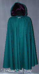 Cloak:2874, Cloak Style:Full Circle Cloak, Cloak Color:Forest Green, Fiber / Weave:100% Wool, Cloak Clasp:Vale, Hood Lining:Purple Velvet, Back Length:45&quot;, Neck Length:20.5&quot;, Seasons:Fall, Winter, Spring, Note:For a dazzling addition to your wardrobe,<br>try this eye catching color combination. <br>This fun and dramatic 100% wool<br>green cloak is lined with a striking<br>purple hood, and finished off with<br>a silver-tone Vale hook-and-eye clasp.<br>Dry Clean Only..