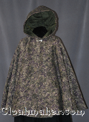 Cloak:2881, Cloak Style:Full Circle Short Cloak<br>(Ranger&#039;s Apprentice), Cloak Color:Mottled Moss green,<br>Dusky purple,<br>Mushroom brown, Tan., Fiber / Weave:100% Polyester, Woven, Cloak Clasp:Alpine Knot - Silvertone, Hood Lining:Dusty Green Velvet, Back Length:32&quot;, Neck Length:21&quot;, Seasons:Fall, Spring, Note:Become invisible in the<br>dense forests of Araluen<br>with this mid length mottled<br>moss green, dusky purple, mushroom brown,<br>and tan cloak.<br>This cloak would be the pride<br>of any Ranger&#039;s Apprentice; short enough<br>for scouting and hiking<br>but long enough to hide from enemies.<br>Machine washable..