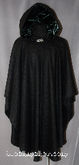 Cloak:2905, Cloak Style:Cape / Ruana, Cloak Color:Black, Fiber / Weave:100% Wool, woven, Cloak Clasp:Vale, Hood Lining:Dark Emerald Green Velvet, Back Length:44&quot;, Neck Length:22&quot;, Seasons:Fall, Spring, Southern Winter, Note:This black Ruana is a great way to<br>keep warm while frequent, unhindered<br>use of your arms is needed.<br>A cross between a cape and a<br>cloak, Ruanas make great driving cloaks!<br>This gorgeous woven wool cloak<br>has a soft, elegant dark<br>emerald lined hood with 28&quot; long sides.<br>Dry Clean Only..