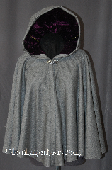 Cloak:2915, Cloak Style:Full Circle Short Cloak, Cloak Color:Grey, Fiber / Weave:100% Wool, Cloak Clasp:Vale, Hood Lining:Amethyst Crushed Velvet, Back Length:27&quot;, Neck Length:20.5&quot;, Seasons:Fall, Spring, Note:This short full circle cloak<br>is perfect for adding just<br>a touch of drama and elegance.<br>Made from a heathered grey<br>100% wool. The hood is<br>lined with crushed<br>velvet amethyst.<br>Then accented with a classic<br>Vale hook-and-eye clasp.<br>Dry Clean only.