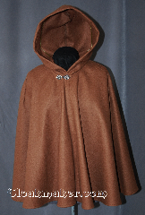 Cloak:2917, Cloak Style:Shaped Shoulder Cloak - Short, Cloak Color:Caramel, Fiber / Weave:100% Wool, Cloak Clasp:Antiquity, Hood Lining:Unlined, Back Length:28&quot;, Neck Length:20&quot;, Seasons:Fall, Spring, Southern Winter, Winter, Note:This caramel short shape<br>shoulder cloak is a great starter<br>cloak or a fashionable alternative<br>to a shawl. Made of 100% wool<br>this cloak is unlined. and accented with a<br>classic antiquity hook-and-eye clasp.<br>Sized for child or young adult.<br>Dry Clean only.