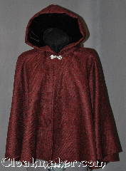 Cloak:2924, Cloak Style:Full Circle Short Cloak, Cloak Color:Black and Maroon, Fiber / Weave:100% Wool, Cloak Clasp:Antiquity, Hood Lining:Black Velvet, Back Length:24&quot;, Neck Length:21&quot;, Seasons:Fall, Spring, Note:This black and maroon full circle<br>short cloak will add respect and<br>awe to any outfit.<br>This gorgeous woven wool cloak<br>has a soft, elegant black lined hood<br>and is perfect for young adults<br>or as a fashionable shawl alternative.<br>Dry Clean Only.