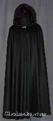 Cloak:2925, Cloak Style:Full Circle Cloak, Cloak Color:Black, Fiber / Weave:100% Cashmere, Cloak Clasp:Vale, Hood Lining:Crushed Purple velvet, Back Length:58&quot;, Neck Length:22&quot;, Seasons:Fall, Spring, Southern Winter, Note:Soft and silky.<br>This black cashmere full<br> circle cloak is a luxurious<br>addition to your fall wardrobe.<br>The jewel tone velvet lined hood<br>and a silver tone vale clasp<br>completes the dreamy look.<br>Dry clean only..