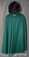 Cloak:2932, Cloak Style:Full Circle Cloak, Cloak Color:Jewel Green, Fiber / Weave:Washed Wool Flannel, Cloak Clasp:Vale, Hood Lining:Purple Velvet, Back Length:42.5&quot;, Neck Length:22.5&quot;, Seasons:Fall, Spring, Note:Made of lightweight washed wool flannel<br>this vibrant green full circle cloak<br>is ideal for outings on cool evenings.<br>Lined with a complementing<br>purple hood for a punch of color.<br>Can be hemmed to height<br>Dry clean only..