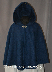 Cloak:2934, Cloak Style:Shaped Shoulder Cloak - Short, Cloak Color:Sapphire Blue and Black, Fiber / Weave:80% Wool / 20% Nylon, Cloak Clasp:Vale, Hood Lining:Unlined, Back Length:27&quot;, Neck Length:21.5&quot;, Seasons:Fall, Spring, Southern Winter, Note:This heathered black and sapphire blue<br> felted shaped shoulder short cloak<br>is a great conversation piece<br>with woven texture that results<br>in subtle variations of color under<br>different lighting.<br>Made of a medium weight wool blend,<br>it is a wonderful cloak for cool<br>evenings in the fall or spring,<br>and is accented with a<br>silver tone Vale clasp.<br>This cloak is sized for<br>young adults and older.<br>Dry Clean only..