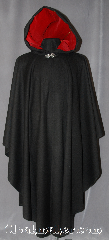 Cloak:2935, Cloak Style:Cape / Ruana, Cloak Color:Black, Fiber / Weave:Wool Blend Coating, Cloak Clasp:Vale, Hood Lining:Cherry Red Cotton Velveteen, Back Length:49&quot;, Neck Length:23&quot;, Seasons:Fall, Spring, Note:A cross between a cape and a cloak,<br>a ruana is a great way to keep warm<br>while frequent, unhindered use of<br>your arms is needed.<br>Ruanas make great driving cloaks!<br>This gorgeous wool blend is<br>accented with a cherry red<br>cotton velveteen hood lining<br>and silver vale clasp.<br>Dry Clean Only.
