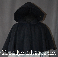 Cloak:2936, Cloak Style:Full Circle Short Capelet, Cloak Color:Navy Blue, Fiber / Weave:Wool Blend Suiting, Cloak Clasp:Snap Button, Hood Lining:Unlined, Back Length:26&quot;, Neck Length:20&quot;, Seasons:Spring, Fall, Note:Perfect starter cloak for a child or a<br>fashionable alternative to a shawl.<br>This navy blue short capelet is made<br>of a lightweight fabric.<br>Easy to use snap clasp allows for<br> quick dressing on cool evenings.<br>A fun addition to any wardrobe.<br>Dry Clean Only..