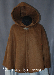 Cloak:2937, Cloak Style:Shaped Shoulder Cloak - Short, Cloak Color:Brown, Fiber / Weave:80% Wool / 20% Nylon, Cloak Clasp:Vale, Hood Lining:Unlined, Back Length:25&quot;, Neck Length:18&quot;, Seasons:Spring, Fall, Note:A felted brown wool short<br>shape shoulder cloak<br>sized for a child is<br>perfect for cool evenings.<br>Designed to grow with a child<br>into young adulthood.<br>Accented with a silvertone vale clasp.<br>Dry clean only..