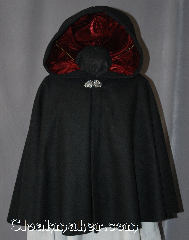 Cloak:2941, Cloak Style:Full Circle Short Cloak, Cloak Color:Black, Fiber / Weave:80% Wool/20% Cashmere, Cloak Clasp:Vale, Hood Lining:Cranberry Red Velvet, Back Length:24.5&quot;, Neck Length:21&quot;, Seasons:Fall, Spring, Southern Winter, Note:Perfect Starter cloak for a child or a<br>fashionable alternative to a shawl.<br>This black short cloak is made of<br>80% Wool/20% Cashmere<br>and feels like soft felt.<br>The Cranberry velvet lined hood<br>and silver vale clasp complete<br>the look for cool evening.<br>A fun addition to any wardrobe.<br>Dry Clean Only..