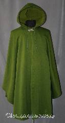 Cloak:2945, Cloak Style:Shaped Shoulder Ruana Cloak, Cloak Color:Green<br>tiny checkerboard-like pattern, Fiber / Weave:Windpro Fleece lightweight, Cloak Clasp:Vale, Hood Lining:Green Fleece lined, Back Length:41&quot;, Neck Length:21&quot;, Seasons:Fall, Spring, Note:Fully lined Green cloak with a tiny<br>checkerboard like pattern.<br>Lightweight, perfect for<br>woodland adventures.<br>The added drawstring hood will<br>keep it in place on windy days.<br>A cross between a cape and a cloak,<br>a ruana is a great way to keep<br>warm while frequent, unhindered<br>use of your arms is needed.<br>Ruanas make great driving cloaks!<br> Machine washable.
