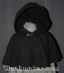 Cloak:2948, Cloak Style:Shaped Shoulder Cloak - Short, Cloak Color:Heathered Charcoal Grey, Fiber / Weave:80% Wool / 20% Nylon, Cloak Clasp:Antiquity, Hood Lining:Unlined, Back Length:16&quot;, Neck Length:20&quot;, Seasons:Fall, Spring, Note:Perfect Starter cloak for a child<br>or a fashionable alternative<br>to a shawl.<br>This dark grey short cloak<br>is made of a heathered woo<br>blend and feels like felt.<br>The silver tone antiquity<br>hook and eye clasp completes<br>the look for cool evenings.<br>A fun addition to any wardrobe.<br>Dry Clean Only.<br>Pictured with robe R285 sold separately..