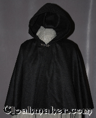 Cloak:2952, Cloak Style:Shaped Shoulder Cloak - Short, Cloak Color:Black, Fiber / Weave:100% Wool, Cloak Clasp:Antiquity, Hood Lining:Unlined, Back Length:21.5&quot;, Neck Length:18.5&quot;, Seasons:Fall, Spring, Note:Perfect Starter cloak for a child<br>or a fashionable alternative<br>to a shawl.<br>This black short cloak<br>is made of a 100% wool with a silver tone antiquity<br>hook and eye clasp completes<br>the look for cool evenings.<br>A fun addition to any wardrobe.<br>Dry Clean Only.<br>Pictured with robe R285 sold separately..