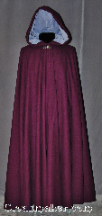 Cloak:2953, Cloak Style:Full Circle Cloak, Cloak Color:Plum Purple, Fiber / Weave:80% Wool / 20% Nylon, Cloak Clasp:Vale, Hood Lining:Periwinkle Cotton Velvet, Back Length:54.5&quot;, Neck Length:20&quot;, Seasons:Fall, Spring, Southern Winter, Winter, Note:Rich as plum cake this full circle<br>cloak has a soft complementary<br>periwinkle lined hood and<br>silver tone vale clasp..
