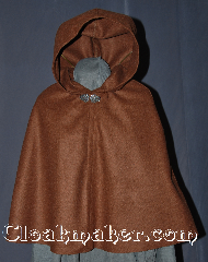 Cloak:2955, Cloak Style:Shaped Shoulder Cloak - Short, Cloak Color:Heathered Brown, Fiber / Weave:80% Wool / 20% Nylon, Cloak Clasp:Vale, Hood Lining:Unlined, Back Length:23&quot;, Neck Length:18.5&quot;, Seasons:Fall, Spring, Note:Perfect Starter cloak for a child<br>or a fashionable alternative<br>to a shawl for a youth.<br>This caramel flecked short cloak<br>is made of a hard finish melton wool<br>that is wind resistant to allow for<br>warmth during average winter months.<br>Because of this the fabric is less soft<br>and slightly stiffer than most cloaks.<br>This will lessen with use.<br>Accented with a silver tone vale<br> hook and eye clasp to complete<br>the look for cool evenings.<br>A fun addition to any wardrobe.<br>Dry Clean Only.<br>Pictured with robe R285 sold separately..