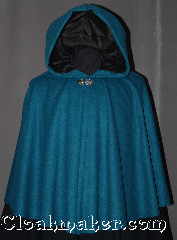 Cloak:2995, Cloak Style:Short Full Circle, Cloak Color:Teal, Fiber / Weave:100% Wool, Cloak Clasp:Vale, Hood Lining:Black Moleskin, Back Length:25&quot;, Neck Length:21.5&quot;, Seasons:Fall, Spring, Note:A lovely starter cloak for a child or adult<br>this short full circle cloak is perfect<br>for adding just a touch of<br>drama and elegance.<br>Made of 100% soft mid weight<br>teal wool with a black moleskin<br>lined hood and adorned with a<br>silver tone veil hook and eye clasp.<br>Dry clean only..