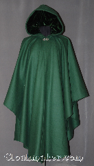 Cloak:3015, Cloak Style:Ruana, Cloak Color:Forest Green, Fiber / Weave:100% Wool, Cloak Clasp:Vale, Hood Lining:Green Velvet, Back Length:49&quot;, Neck Length:22&quot;, Seasons:Fall, Spring, Southern Winter, Winter, Note:This green ruana cloak is a gorgeous<br>Forest green with matching velvet lining.<br>Made of mid-weight wool with<br>shortened sides allowing for a<br> wide range of movement.<br>Perfect for driving on cold days.<br>Accented with a Silver tone<br>Vale hook-and-eye clasp.<br>Dry Clean only..