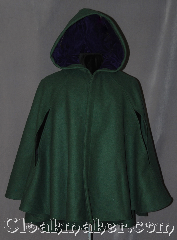 Cloak:3019, Cloak Style:6 Panel Short Cloak<br>with arm holes, Cloak Color:Forest Green, Fiber / Weave:100% Wool, Cloak Clasp:Battle Axes - Silvertone, Hood Lining:Purple Cotton Velveteen, Back Length:33.5&quot; back<br>27&quot; front, Neck Length:20&quot;, Seasons:Fall, Spring, Note:This short cloak is a gorgeous<br>forest green with purple cotton<br>velveteen hood lining.<br>Made of mid-weight wool<br>with arm holes allowing for<br>a wide range of movement.<br>Perfect for driving on cold days.<br>Accented with a Silver tone<br>Battle Axe hook-and-eye clasp.<br>Dry Clean only..