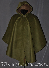 Cloak:3021, Cloak Style:Shaped Shoulder Ruana Cloak, Cloak Color:Mossy Green, Fiber / Weave:100% Polyester<br>Suede outer finish, brushed inner surface, Cloak Clasp:Vale, Hood Lining:Self-lined Brown, Back Length:38&quot; back<br>28.5&quot; overarm, Neck Length:21&quot;, Seasons:Winter, Southern Winter, Fall, Note:Soft and velvety outside and<br>ideal for a cold evenings.<br>This warm mossy green<br>Shape shoulder ruana<br>is self lined in brown fleece<br>with a silver tone vale<br>hook and eye clasp.<br>A cross between a cape<br>and a cloak, a ruana is a<br>great way to keep warm while<br>requent, unhindered use<br>of your arms is needed.<br>Ruanas make great driving cloaks!<br>Machine washable.
